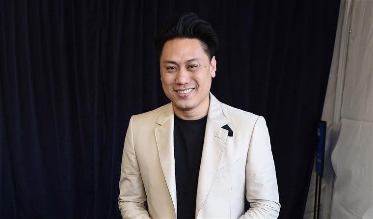 Director Jon M Chu smiling at awards show