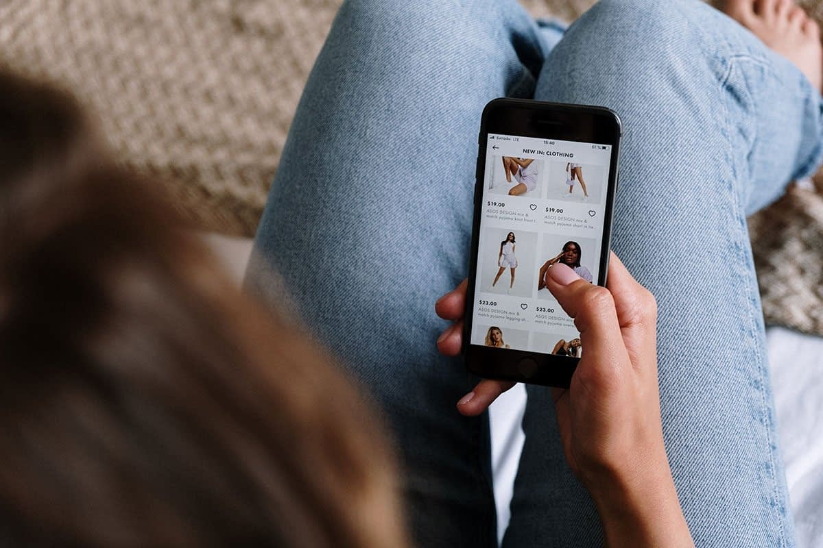 Woman scrolling a mobile-friendly ecommerce site