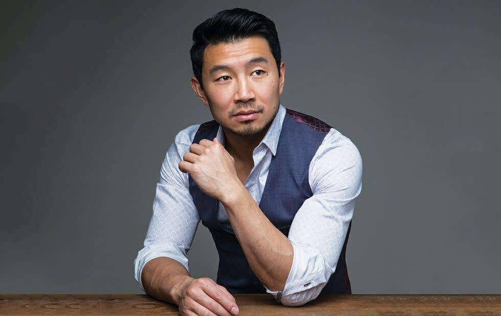 Simu Liu professionally photographed in a blazer