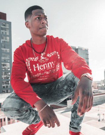 young black man modeling henny apparel shirt