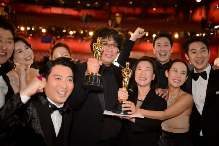 Parasite crew with their awards at the Oscars
