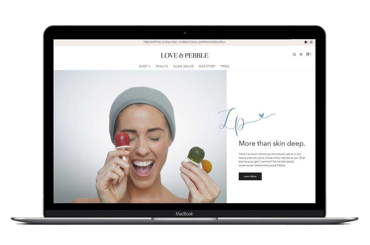 Love & Pebble website mockup on Macbook